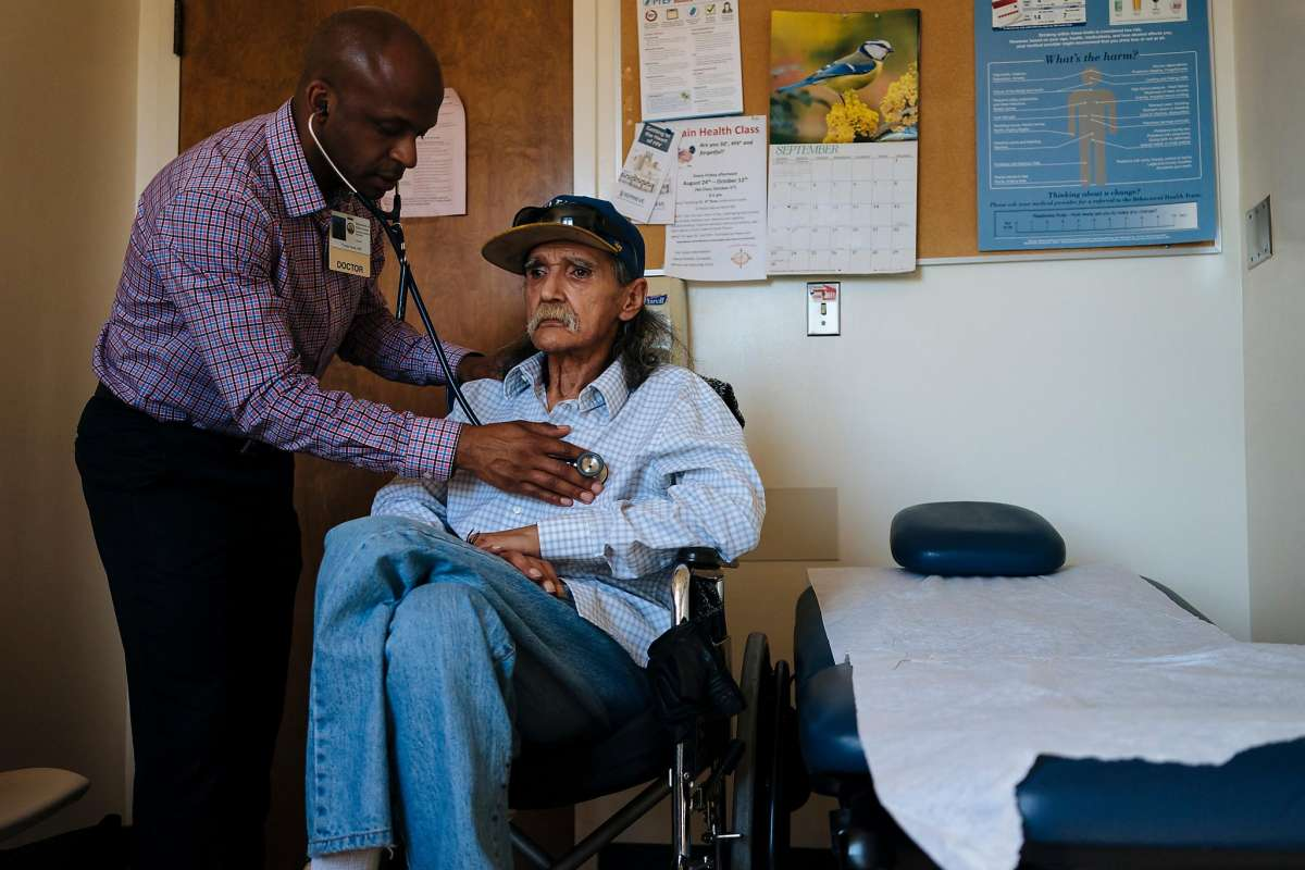 Dr. Hyman Scott, an HIV health care provider, checks the breathing of Richard Ramirez, 67, during a checkup at San Francisco General's Ward 86, which specializes in HIV and AIDS.